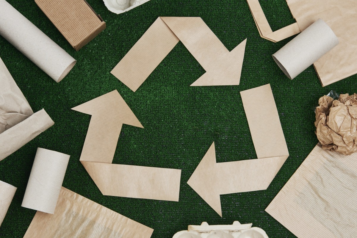 Recycling symbol made of paper