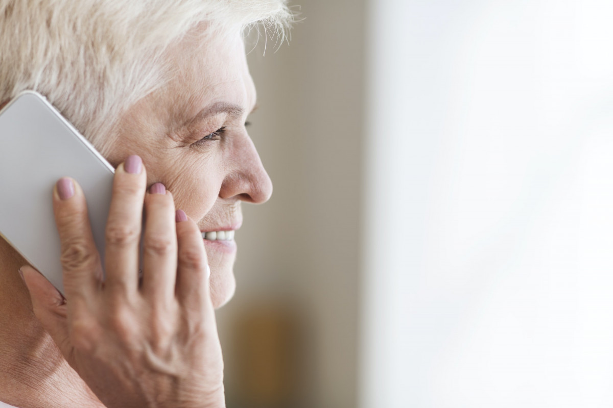 Side view of senior woman talking by phone